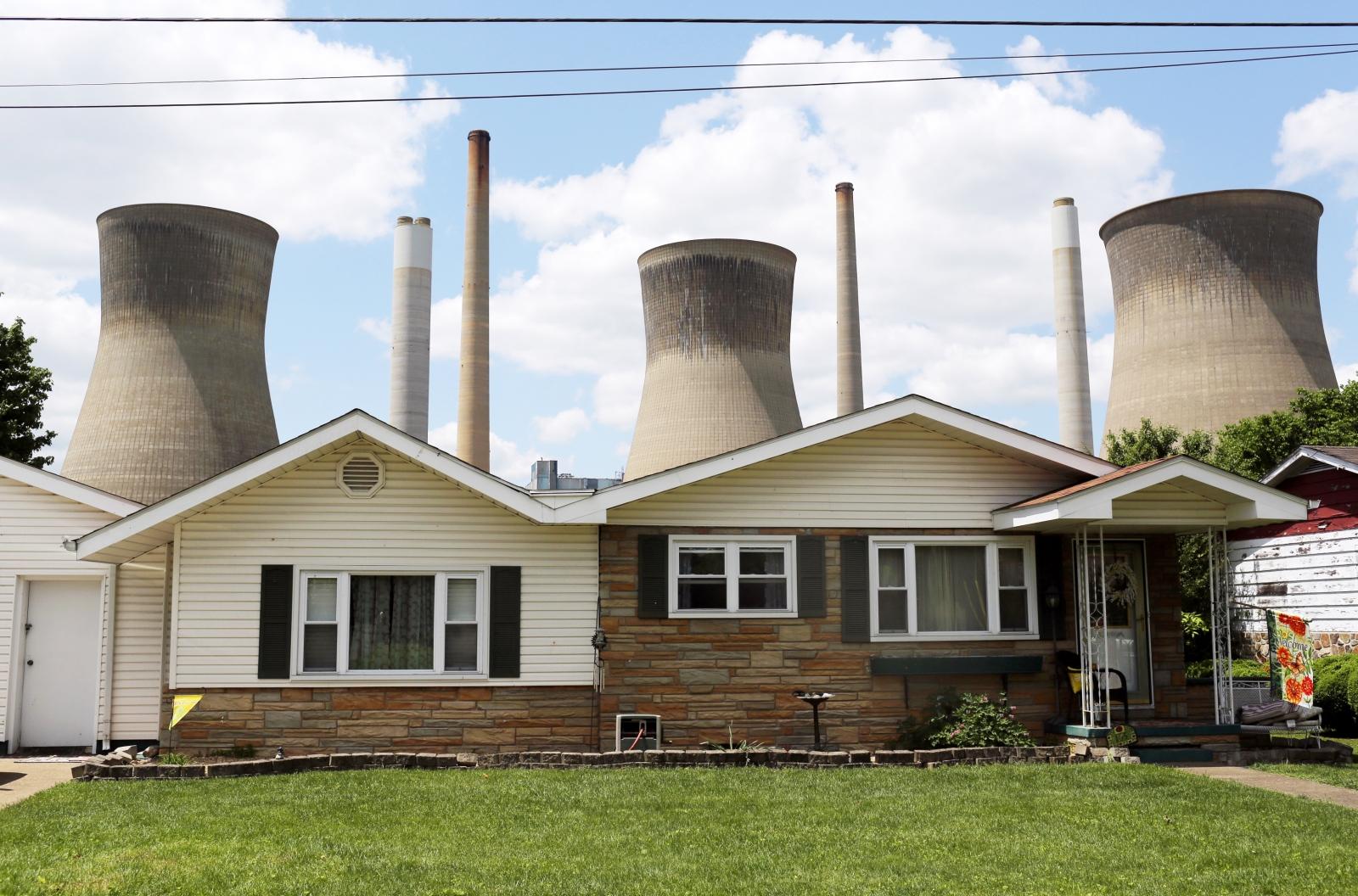 Coal plant seen behind West Virginia home