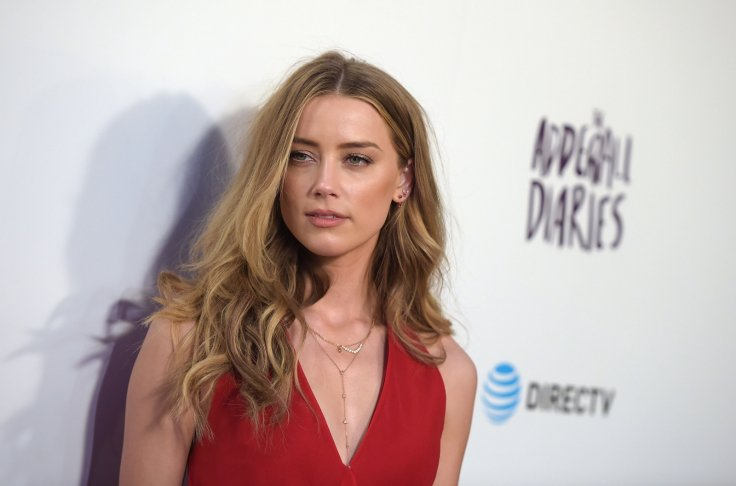 Elon Musk's loss!' Amber Heard goes topless in sexy Instagram photo