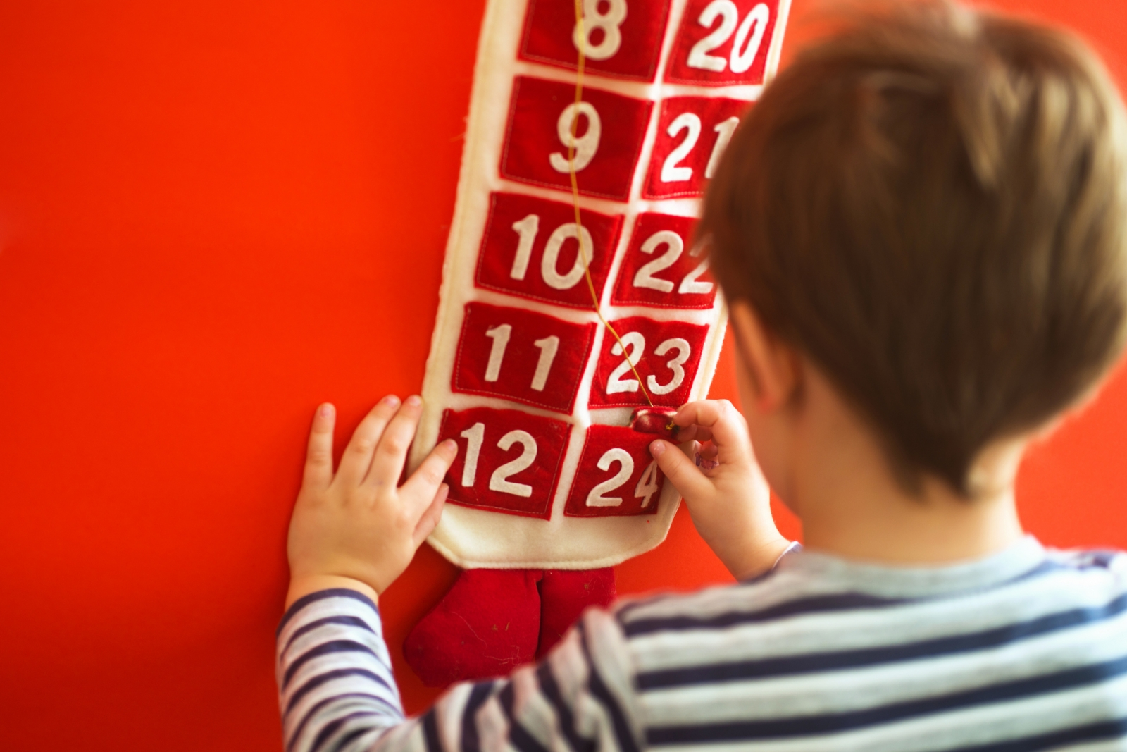 Boy opens Advent calendar