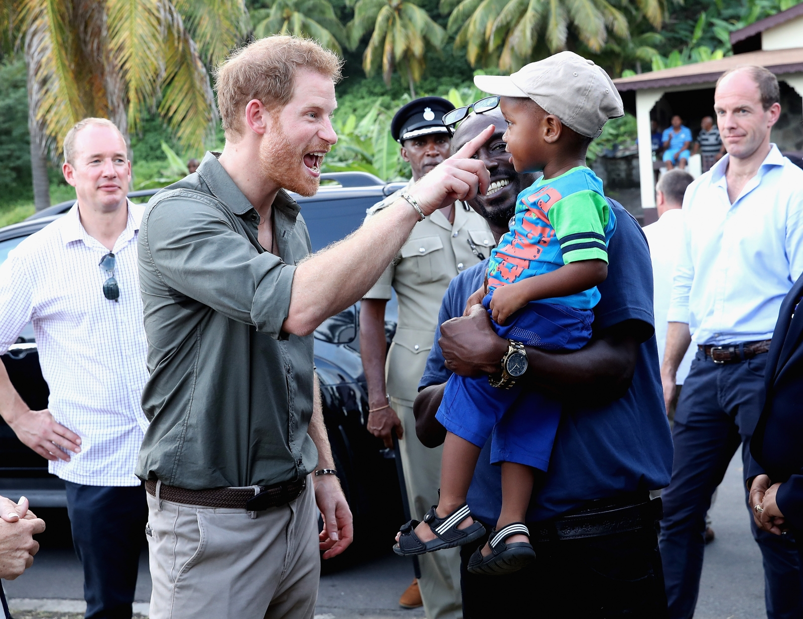 Prince harry meets child in Caribbean