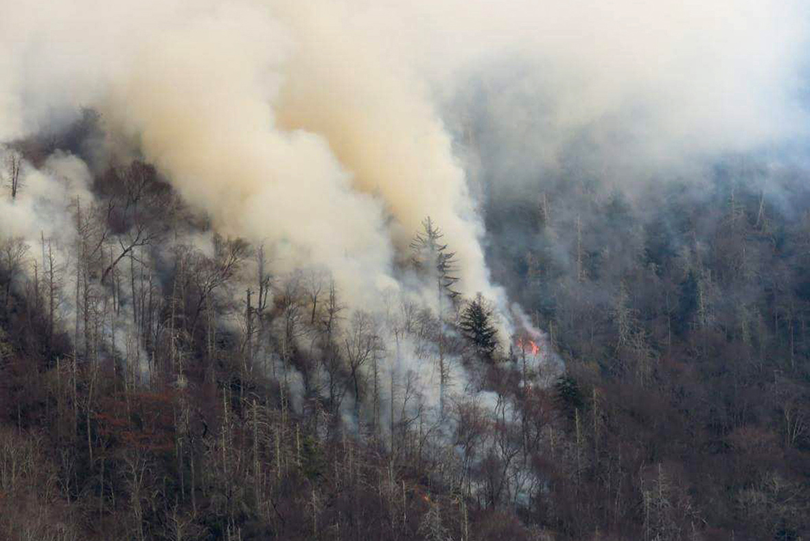 Downtown Gatlinburg, Tennessee evacuated due to wildfires - 30 structures on fire