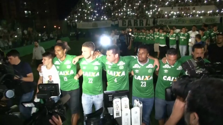 Remaining Chapecoense team join mourners for emotional vigil in club stadium