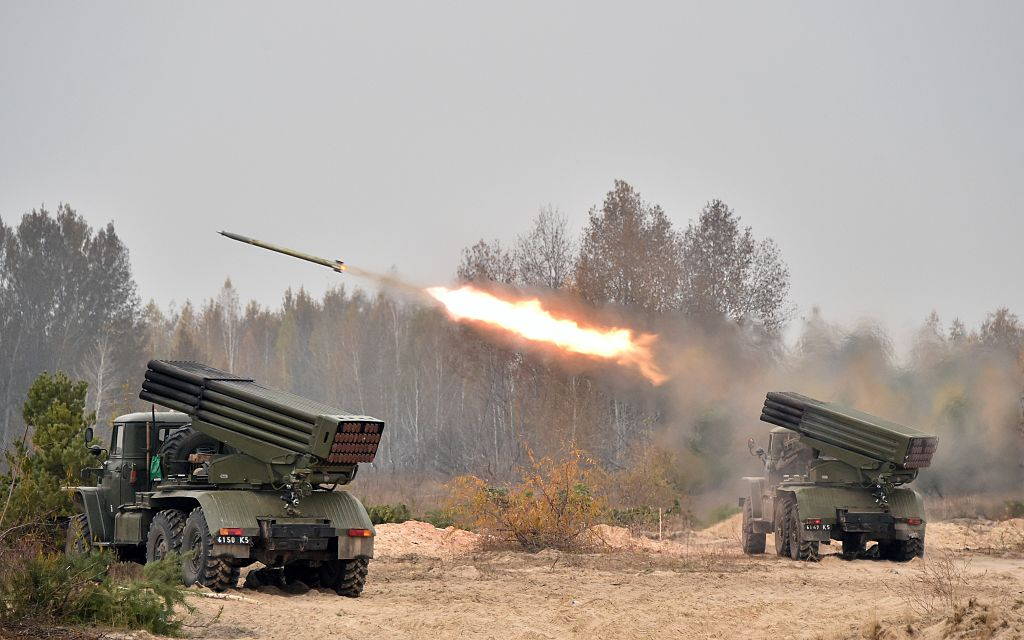 Ukrainian 122 mm MLRS BM-21 Grad fires rocket during a military exercise at a shooting range close to Devichiki in the Kiev region