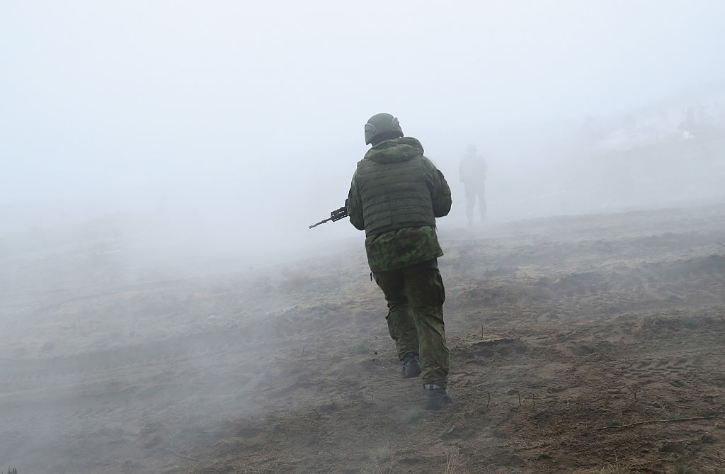 Lithuanian infantry soldiers participate in the Iron Sword multinational military exercises on November 24, 2016 near Pabrade, Lithuania.