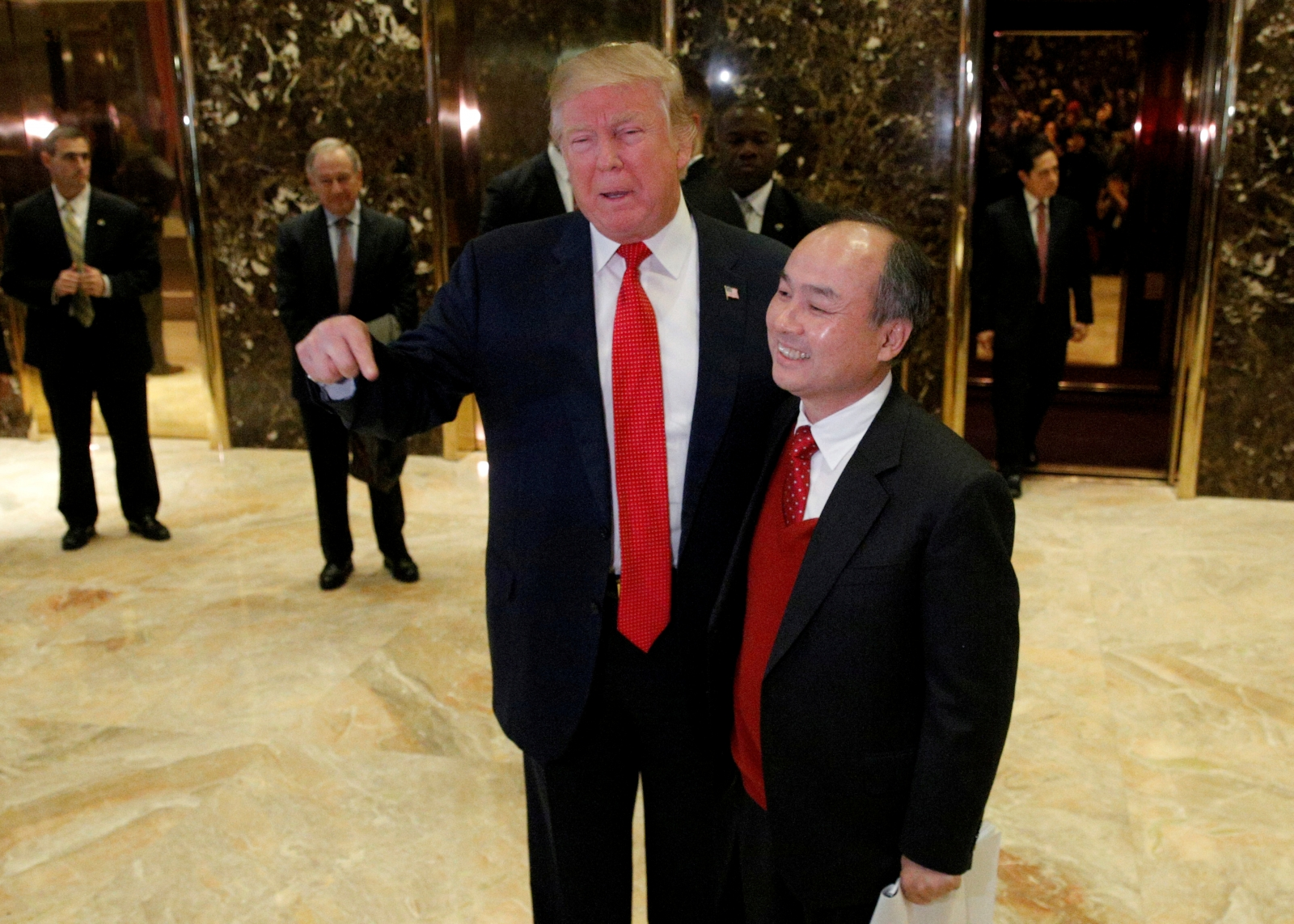 Donald Trump announces SoftBank's plans to invest $50bn and add 50,000 jobs in the US
