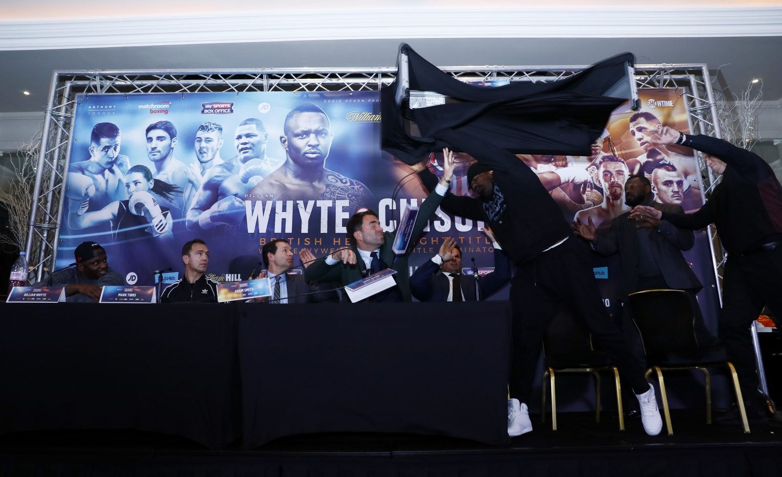 Dereck Chisora tosses table at Dillian Whyte