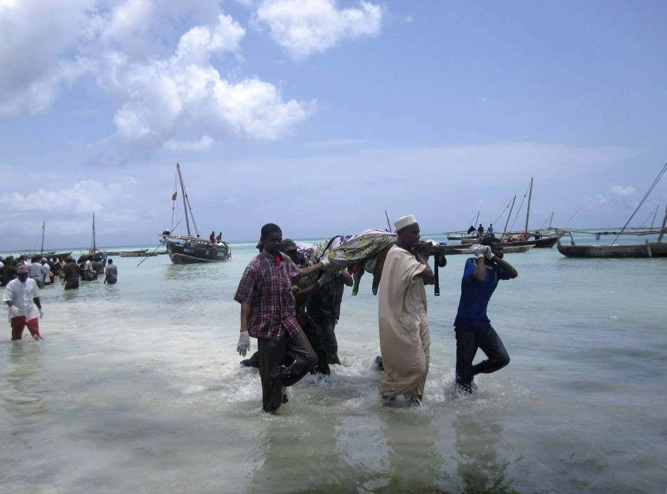 Rescuers carry the bodies of victims from a ferry tragedy near Zanzibar Island at Nungwi Beach