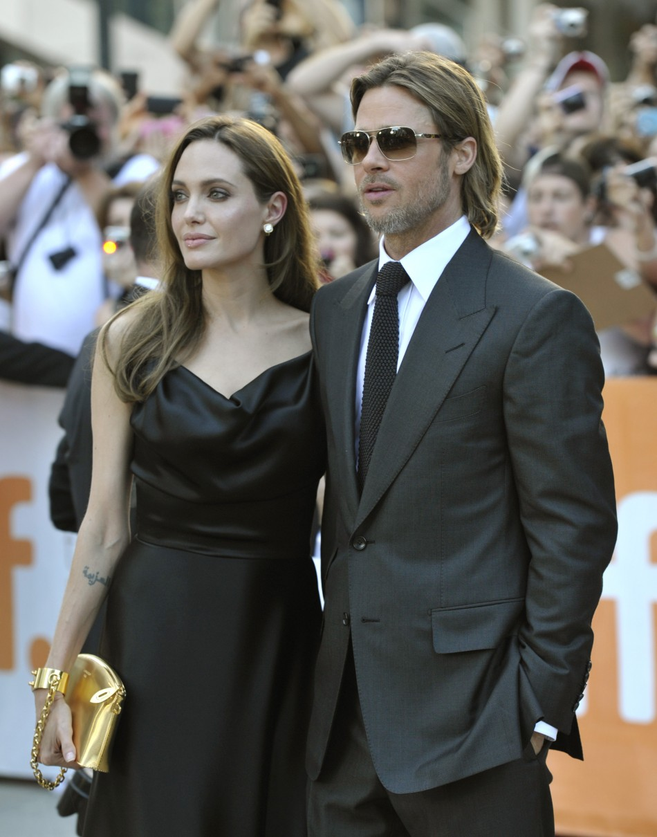 Brad Pitt and Angelina Jolie pose at the gala presentation for the film 'Moneyball' at the Toronto International Film Festival