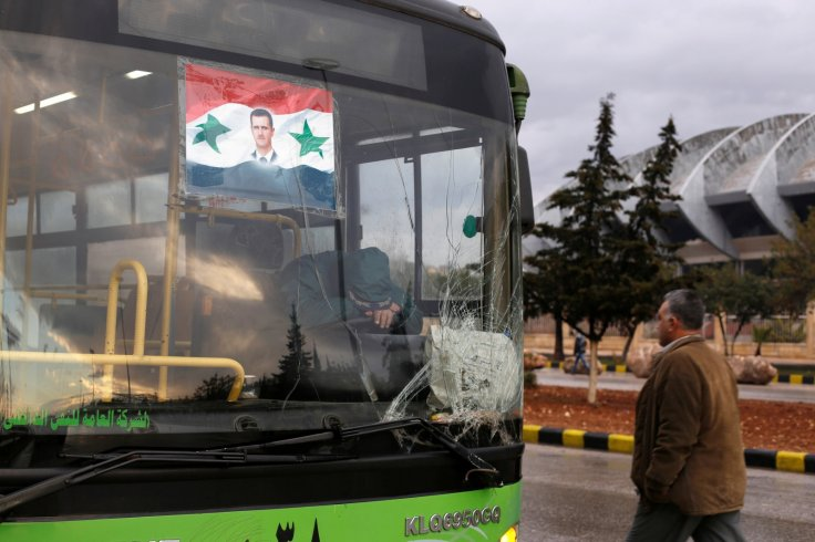 A bus driver waits to evacuate people from a rebel pocket in Aleppo