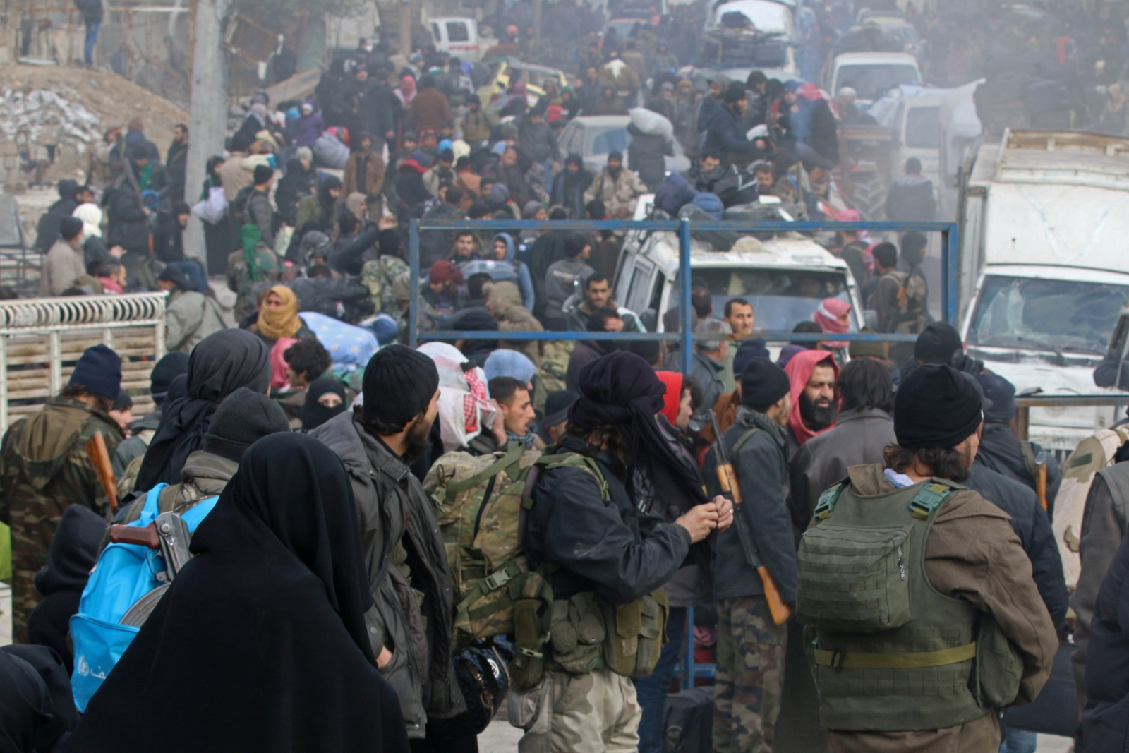 Rebel fighters and civilians gather