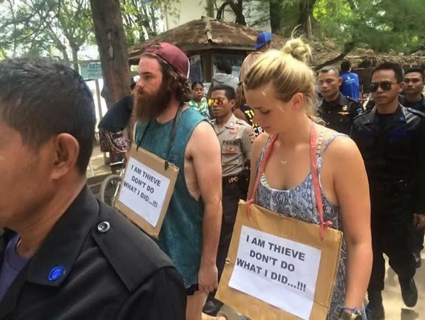 Tourists wear misspelt sign in Indonesia