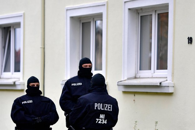Heavily-armed police stand outside an apartment complex where hours earlier they arrested Ahmad Abdulaziz Abdullah A., alias 'Abu Walaa', a 32-year-old imam from Iraq, on November 8, 2016 in Hildesheim, Germany