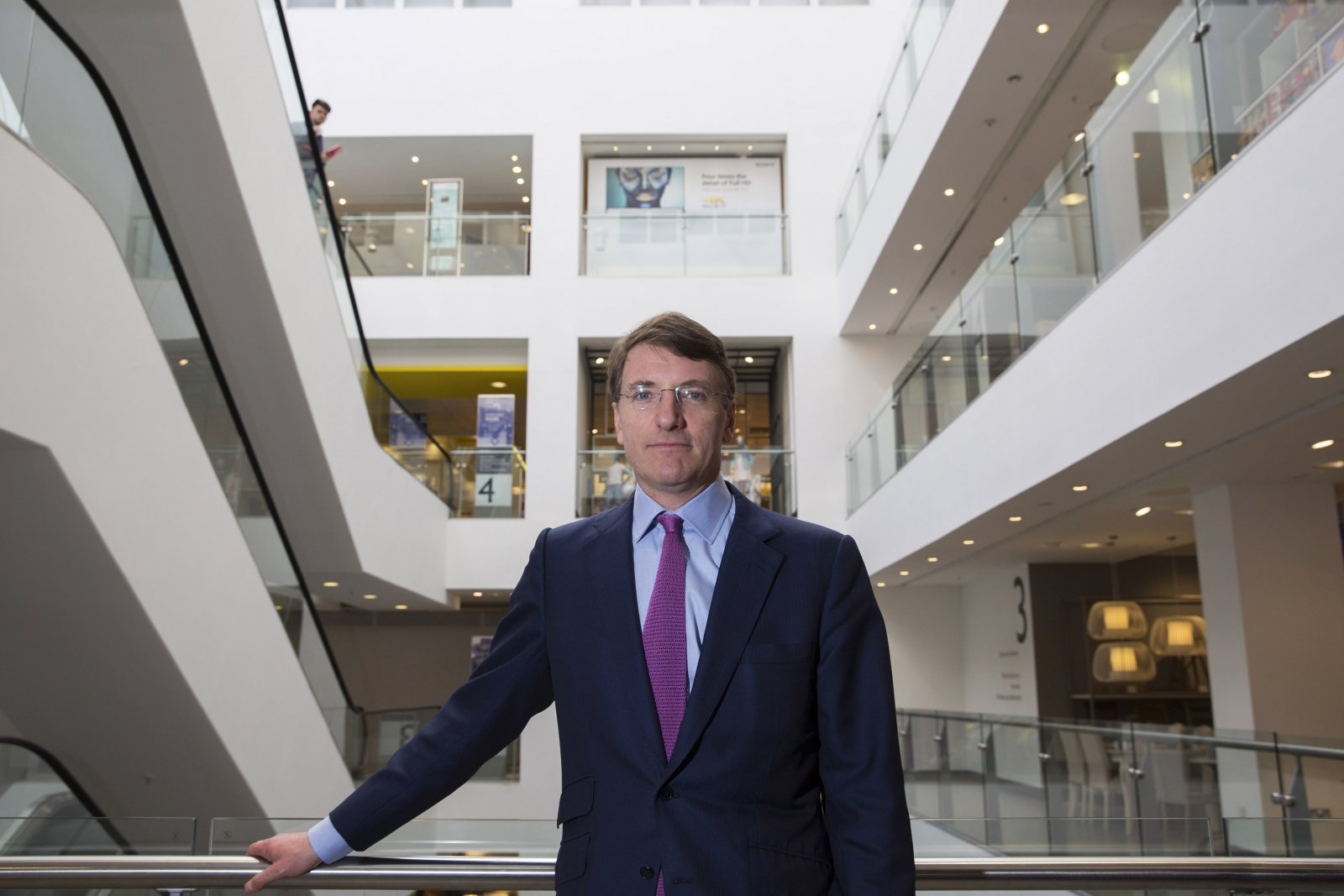 The national living wage introduced in April could spur stronger economic growth, John Lewis boss says