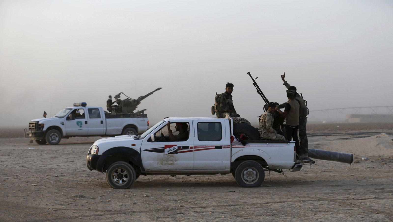 Shi'ite fighters ride vehicles