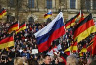 Supporters of the anti-Islam movement Patriotic Europeans Against the Islamisation of the West (PEGIDA) carry German and Russian flags during a demonstration in Dresden, Germany,
