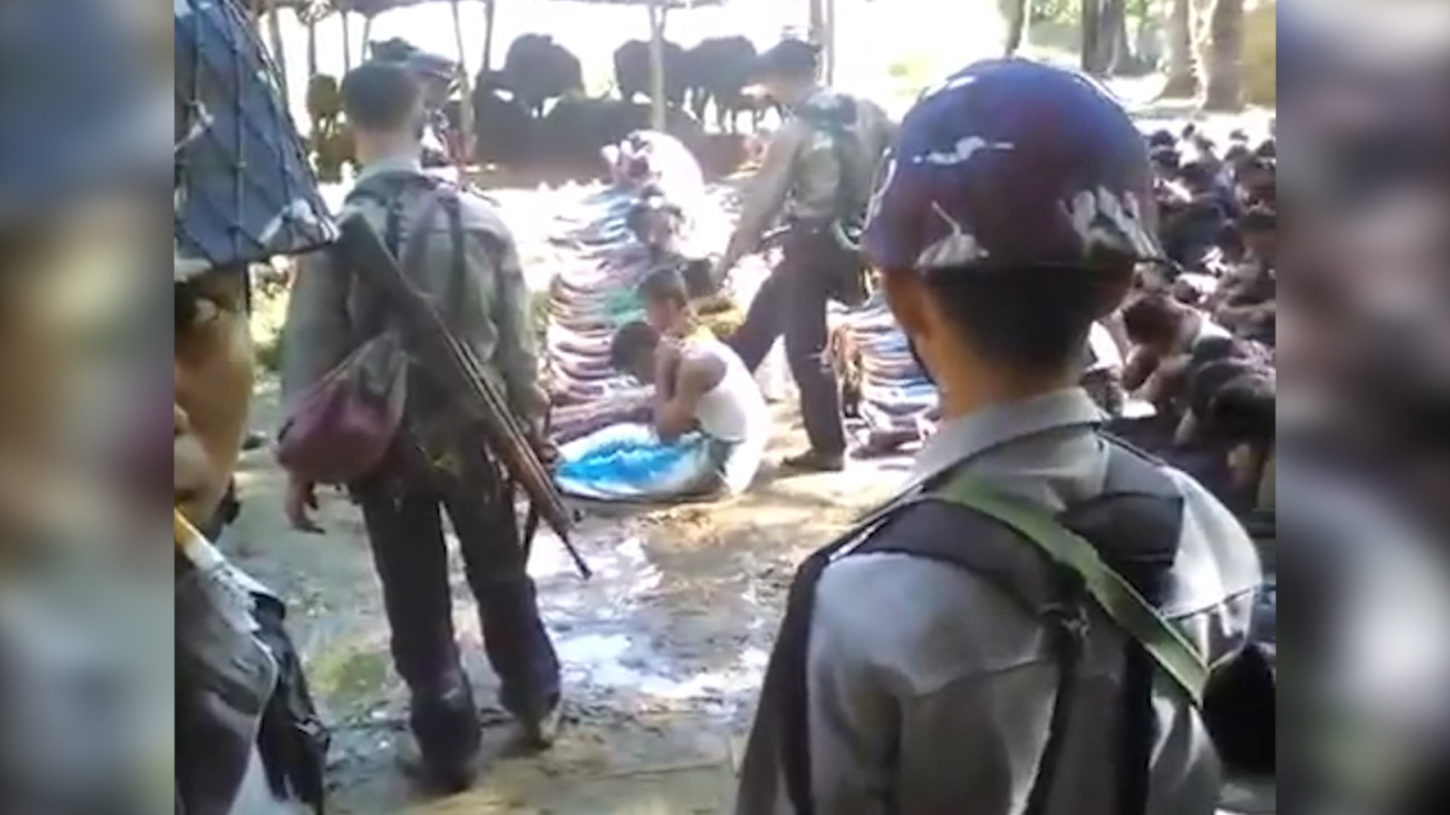 Rohingya civilians being abused by police in Kotankauk Village, Maungdaw