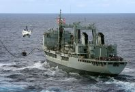 In this handout image provided by Commonwealth of Australia, Department of Defence, HMAS Success conducts a Replenishment at Sea with United States Navy Ship (USNS) Cesar Chavez, as USNS Cesar Chavez\'s helicopter, a Super Puma, conducts a Vertical Replen
