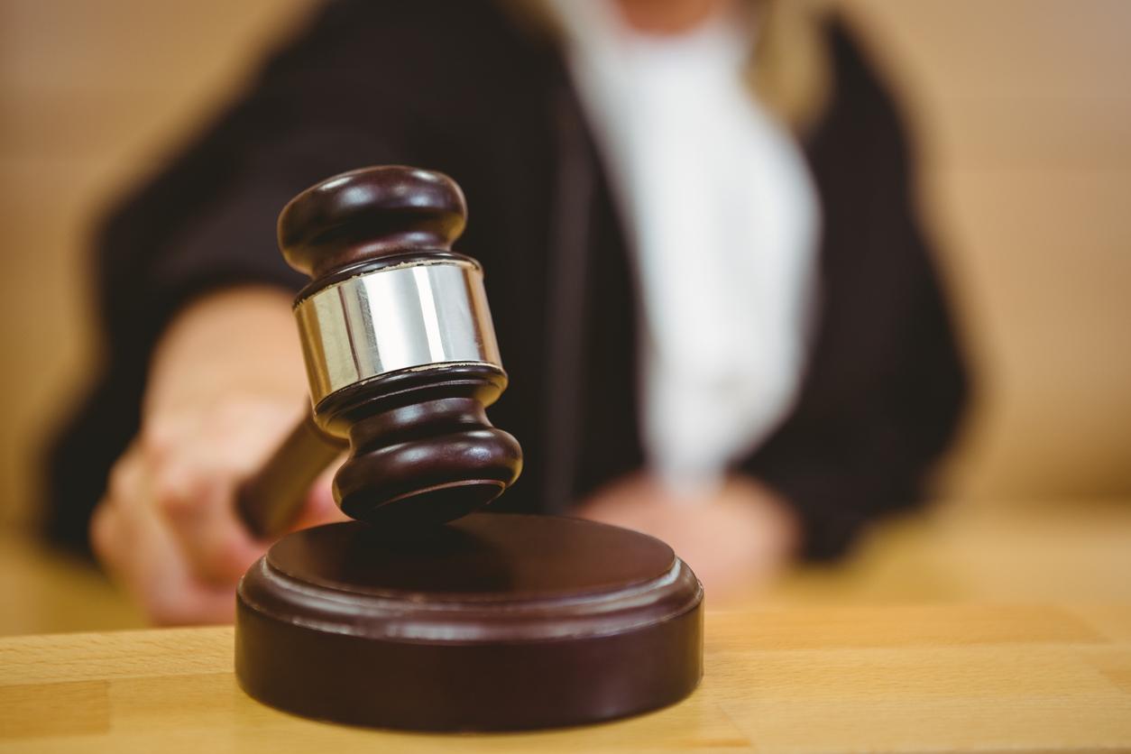 Female judge banging a gavel