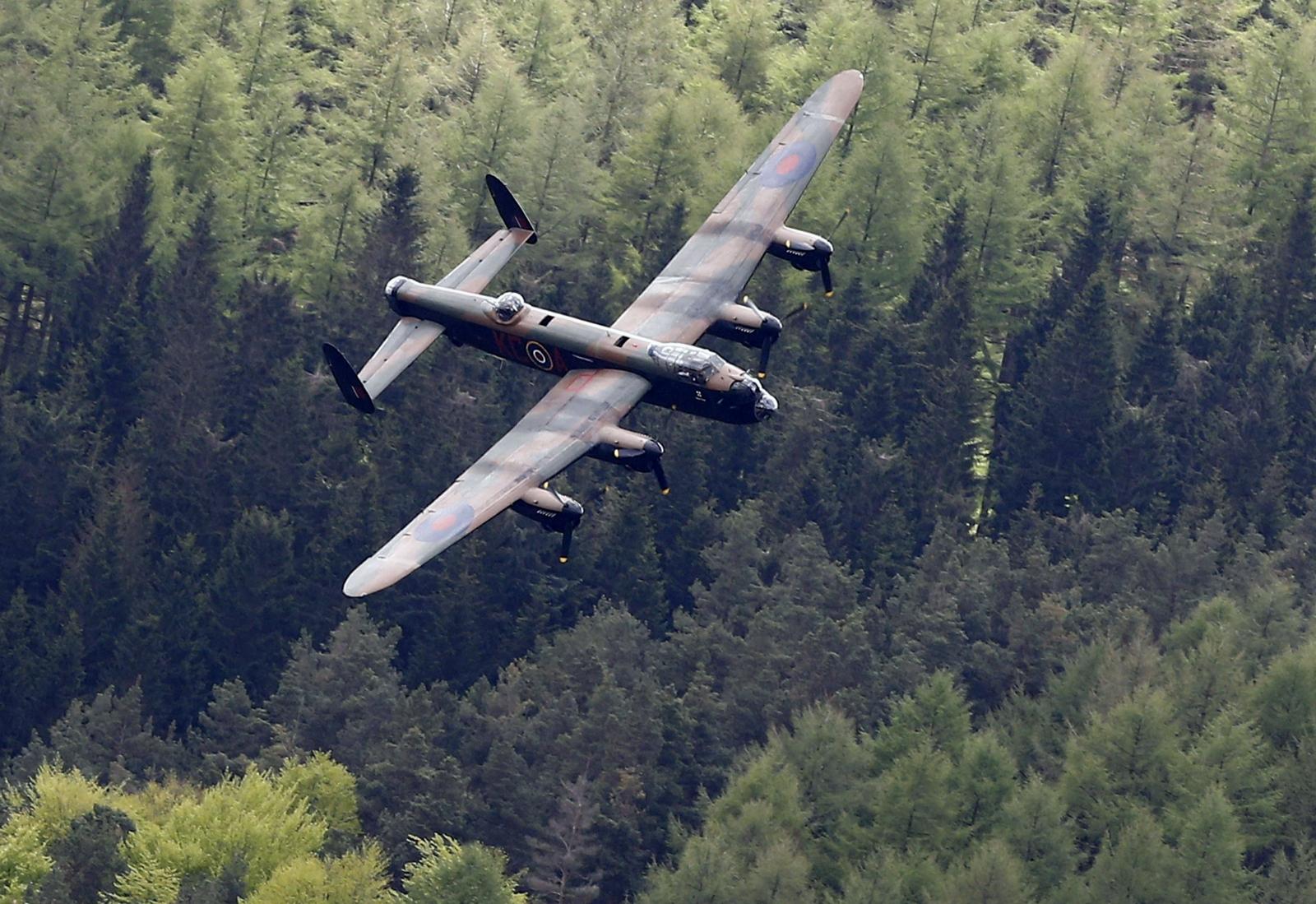 Lancaster bomber swoops over Derwent dam