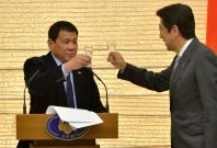 Japan PM Shinzo Abe and Philippines' Duterte