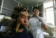 A young Chinese internet addict receives an electroencephalogram check at the Beijing Military Region Central Hospital July 6, 2005 in Beijing, China.