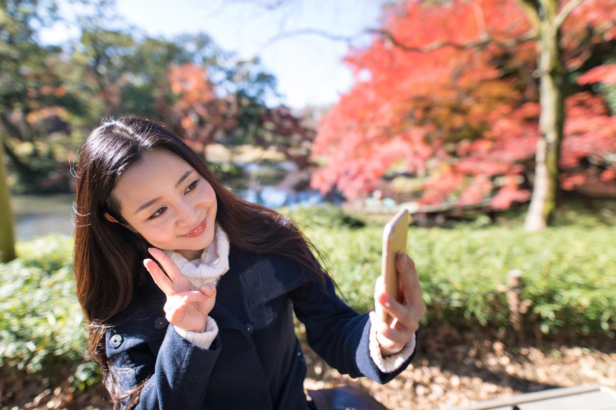 A Japanese woman taking a selfie