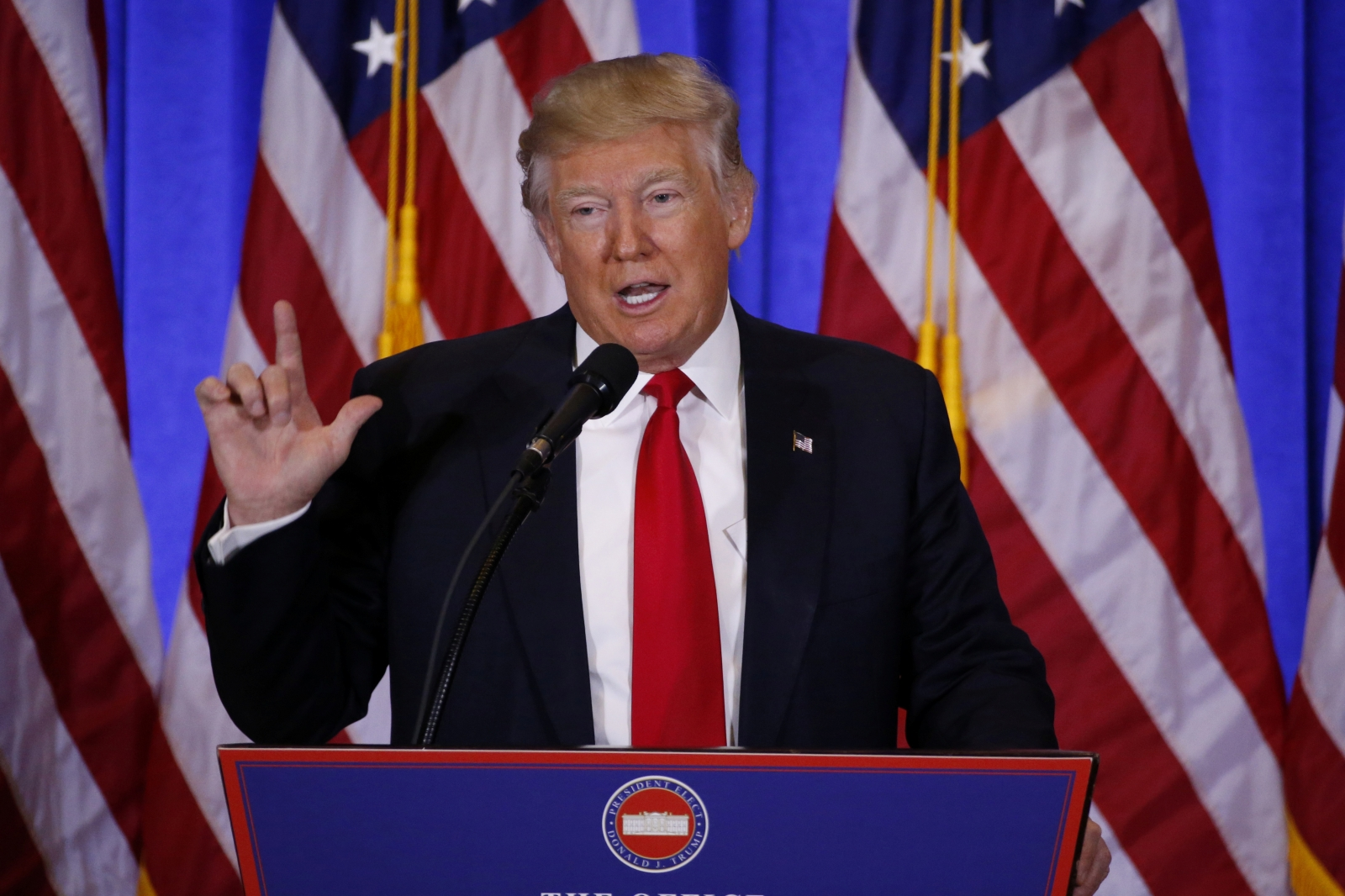 US President-elect Donald Trump speaks during a news conference in the lobby of Trump Tower in Manhattan