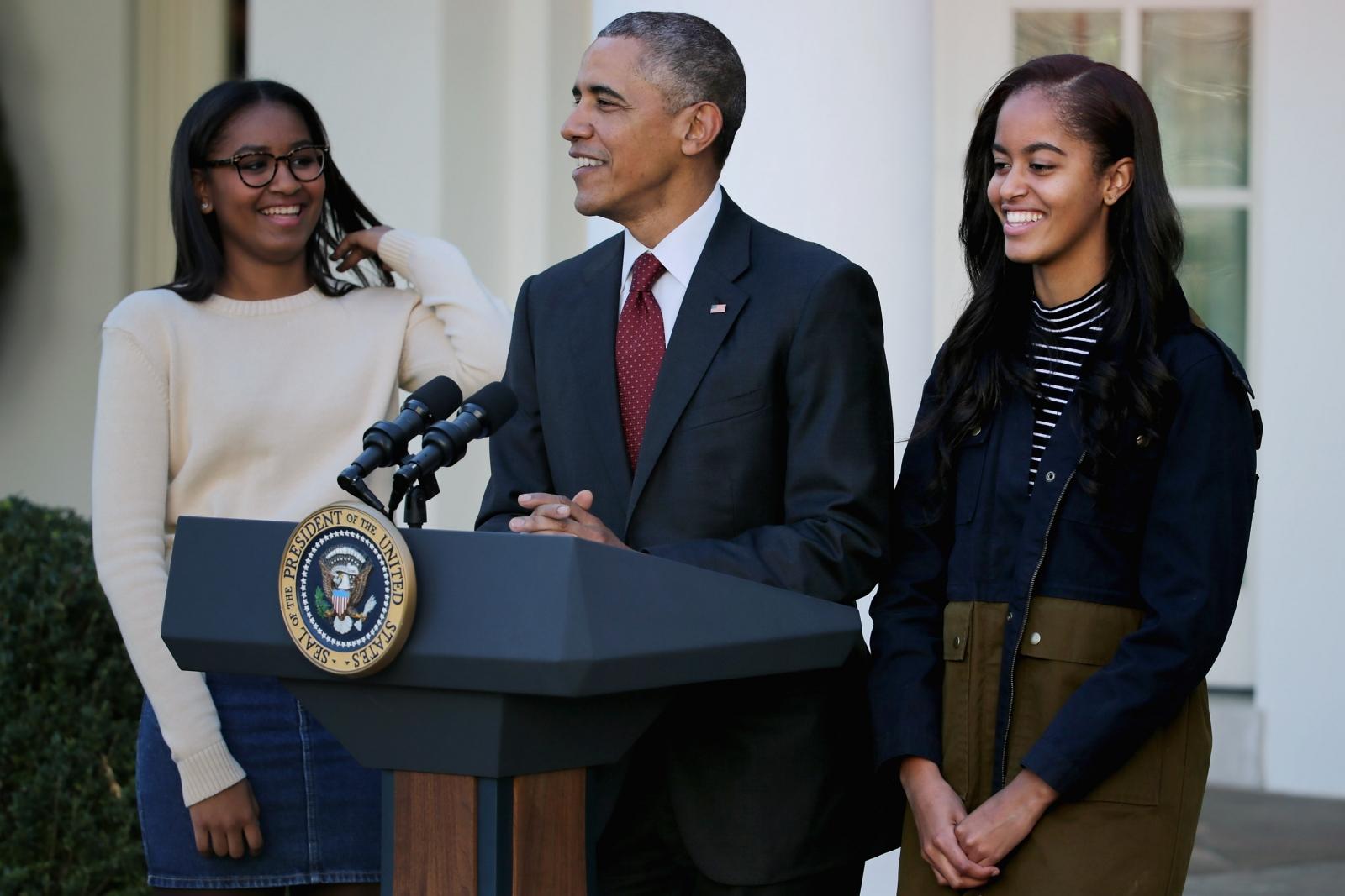 Malia Sasha and Barack Obama