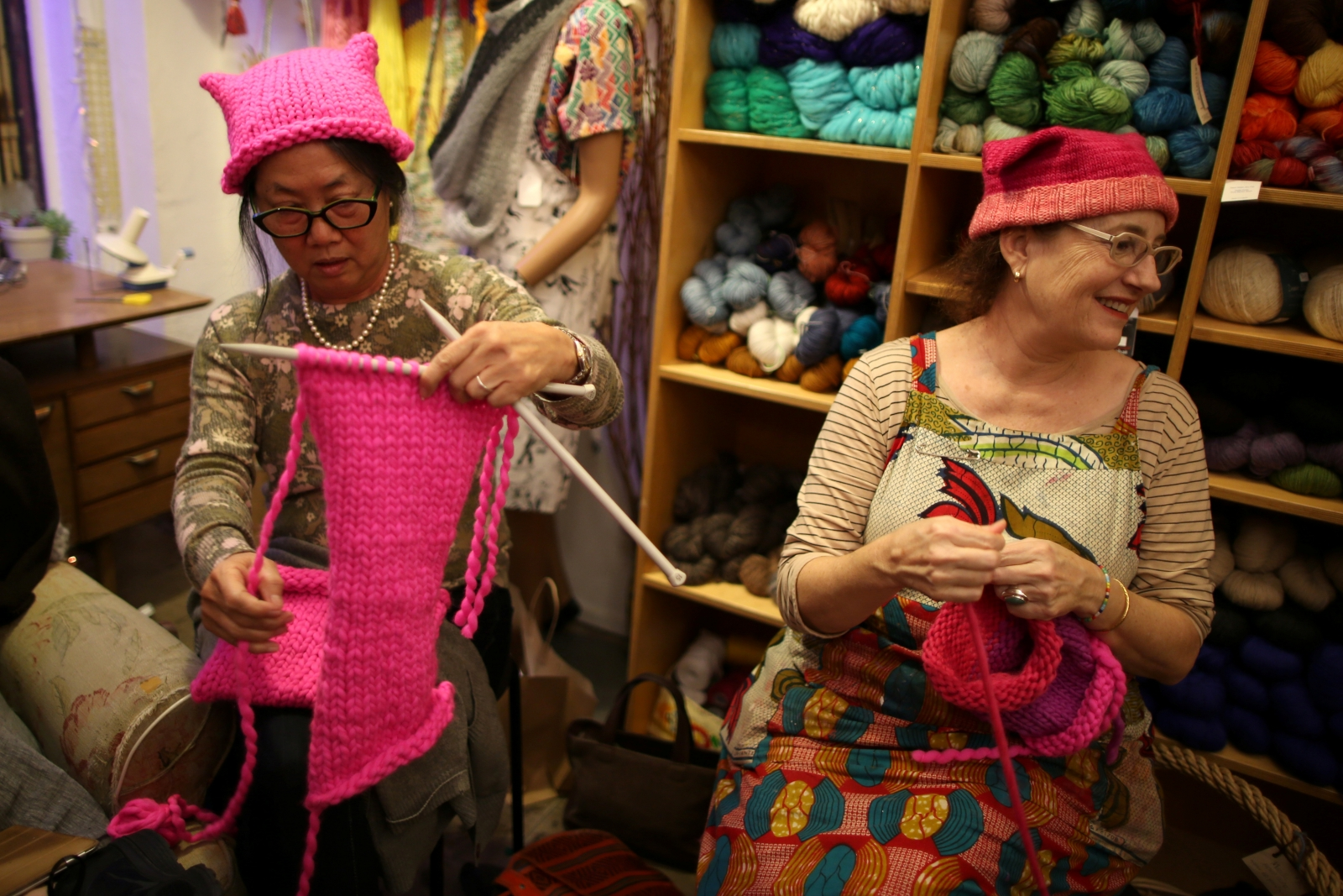 Knitters provide pink hats for protesters in the women's march