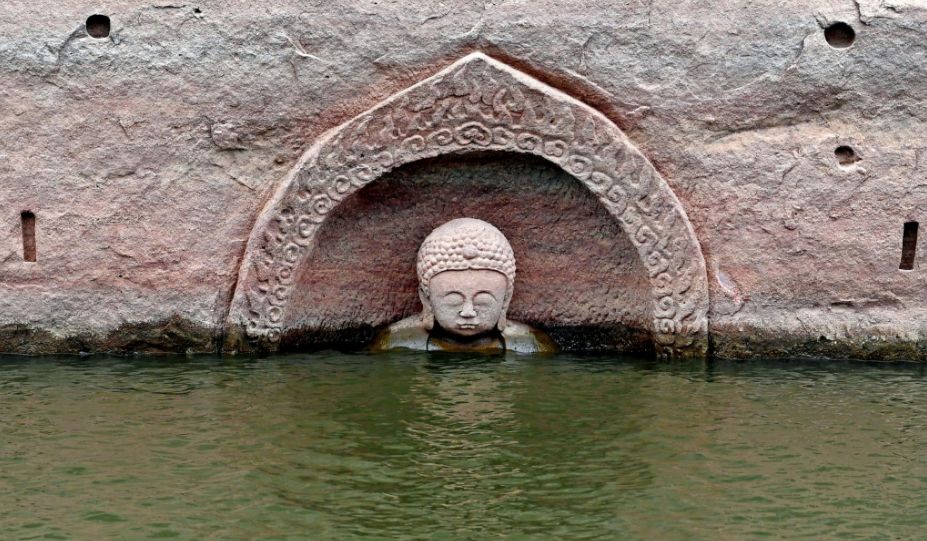 China: Drop in reservoir water levels reveals 600-year-old Buddha statue and a submerged temple