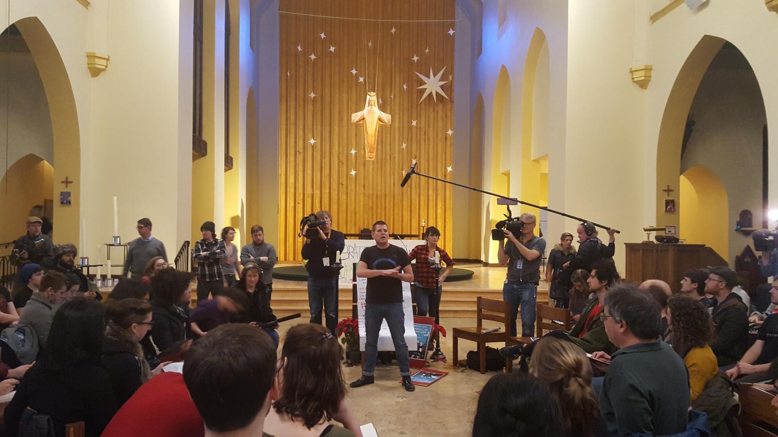DisruptJ20 organiser speaks in a church
