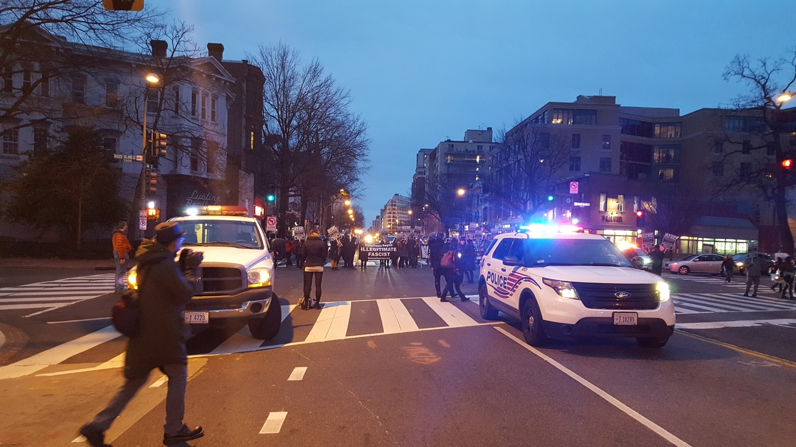 Police cars and protesters in DC