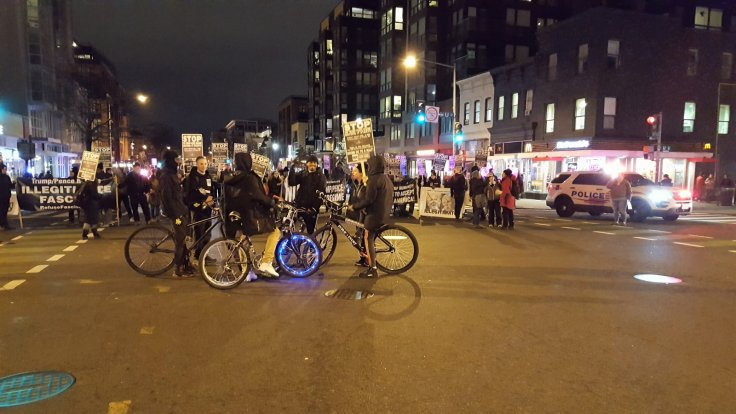 Boys on bikes with protesters in DC