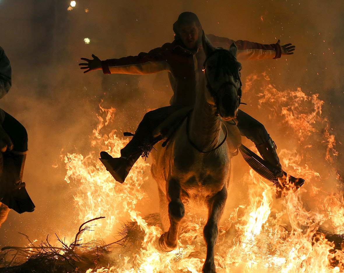 Celebrating the patron saint of animals by riding horses through flames