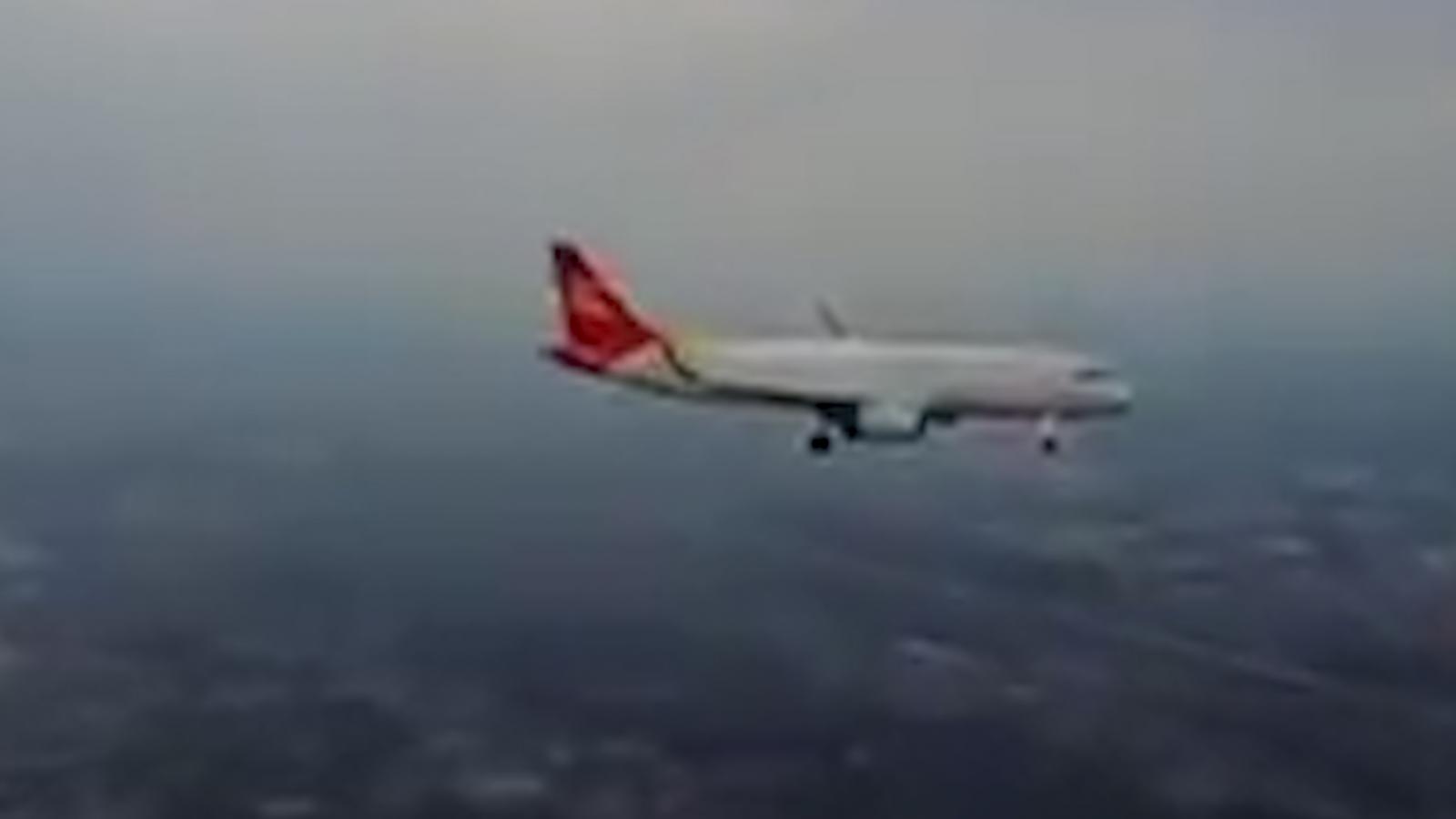 Man flies drone by plane