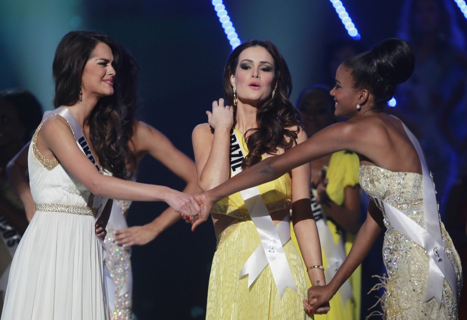 Miss Angola Leila Lopes L, Miss Brazil Priscila Machado C and Miss Ukraine Olesia Stefanko await the judges039 final decision