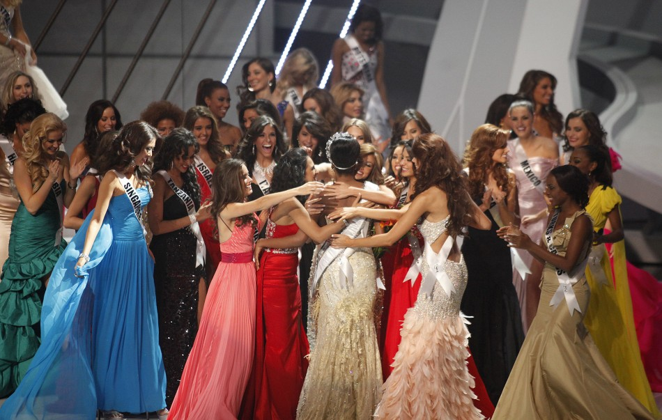 Miss Angola Leila Lopes (C, back to camera) is congratulated by the other contestants after being named Miss Universe 2011 during the Miss Universe pageant in Sao Paulo