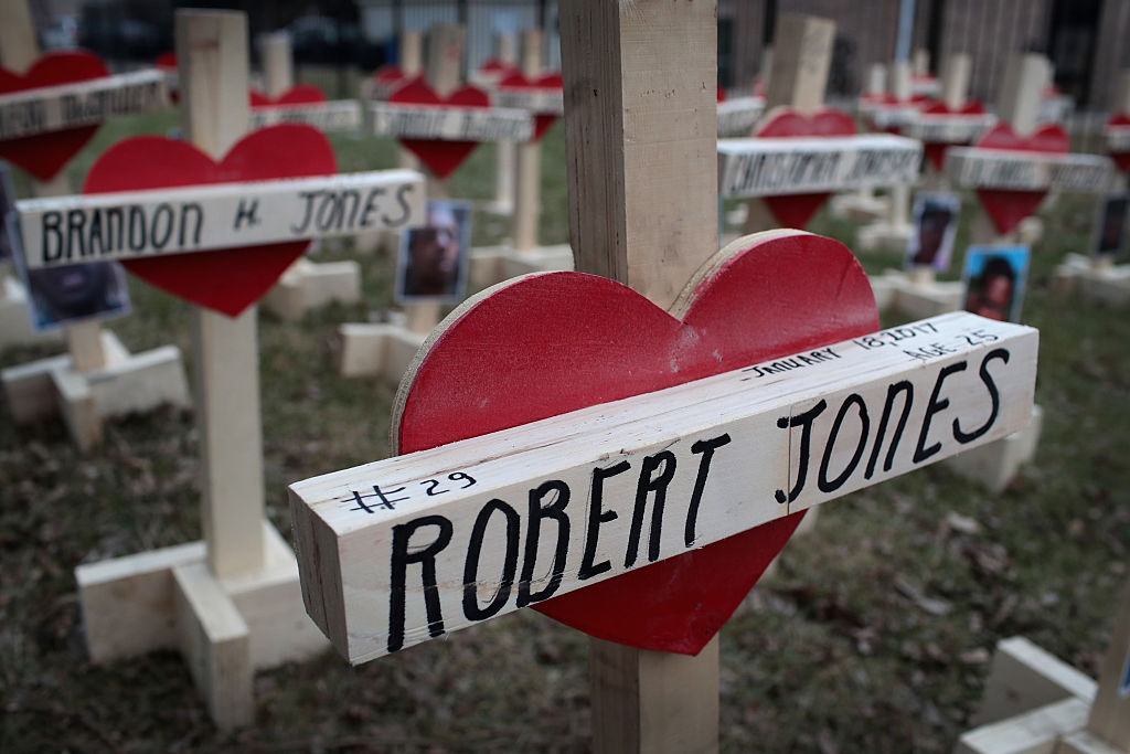 Forty-three crosses sit in a vacant lot in the Englewood neighborhood on January 23, 2017 in Chicago, Illinois. Each cross, created by Greg Zanis, represents a victim of murder in Chicago in 2017.