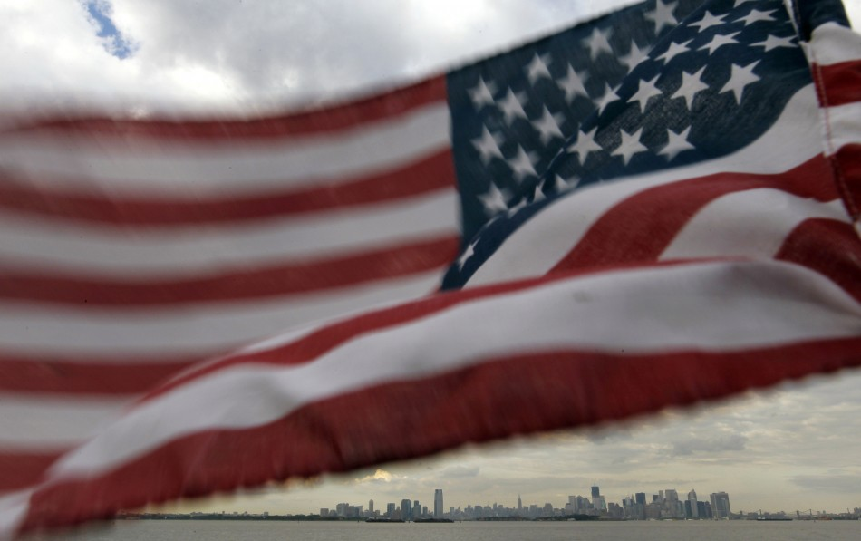 A U.S. flag flutters over top of the skyline of New York and Jersey City as seen from Bayonne, New Jersey