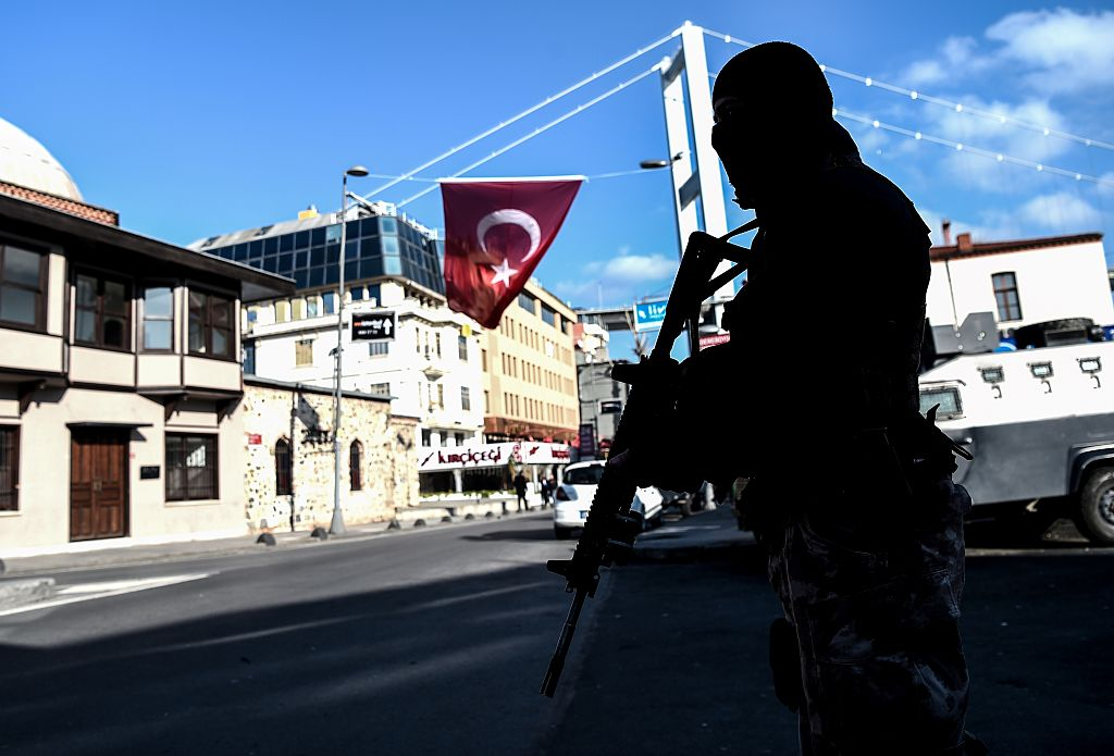 A Turkish special force police officer stands guard at ortakoy district near the Reina night club, on January 2, 2017 in Istanbul, one day after New Year gun attack.