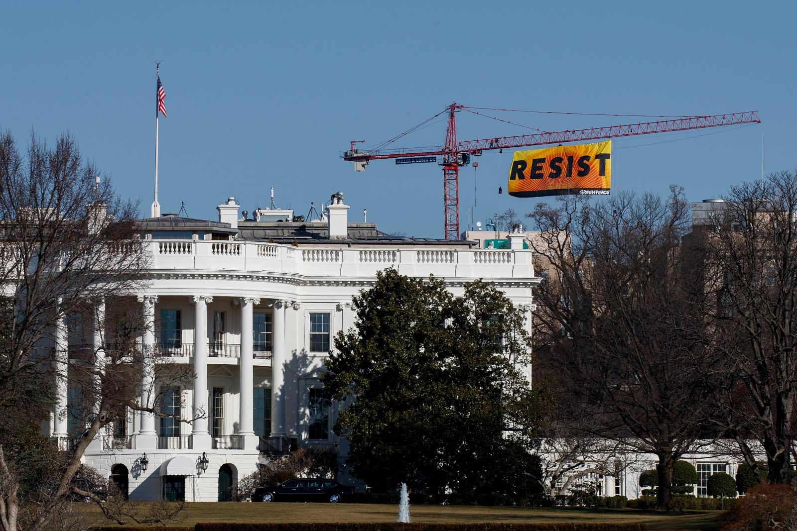 Greenpeace banner resist White House