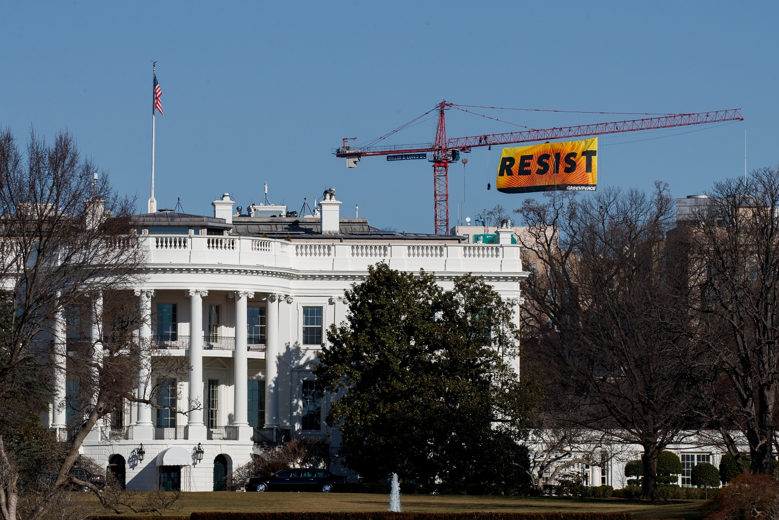 Greenpeace banner resist White House