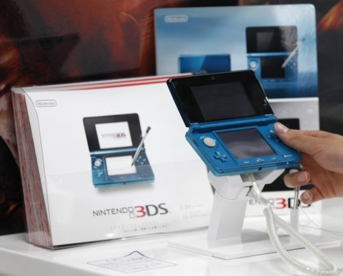 A man plays with the Nintendo 3DS at an electronics shop in Tokyo. REUTERS/Kim Kyung Hoon