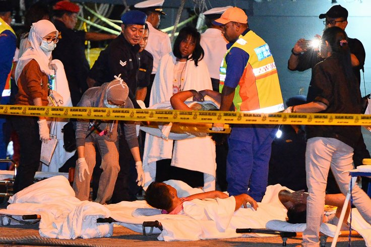 Medics attend survivors of Malaysia boat sinking