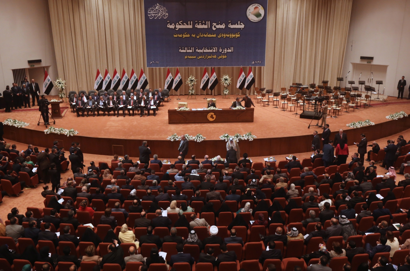 Members of the Iraqi parliament gather to vote