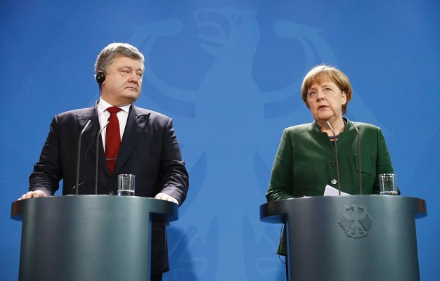 German Chancellor Angela Merkel and Ukraine's President Petro Poroshenko give press statements prior to their talks at the Chancellery in Berlin on January 30, 2017