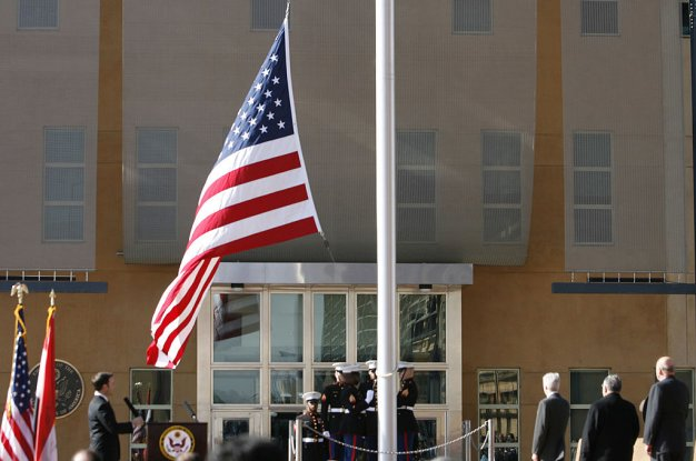 The US flag is raised during a formal dedication ceremony