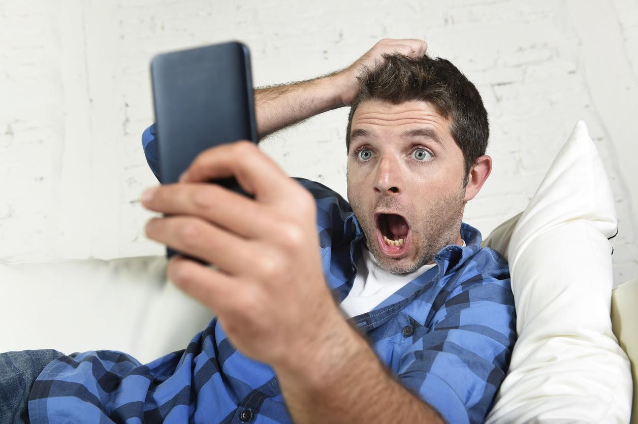 Smartphone anguished man