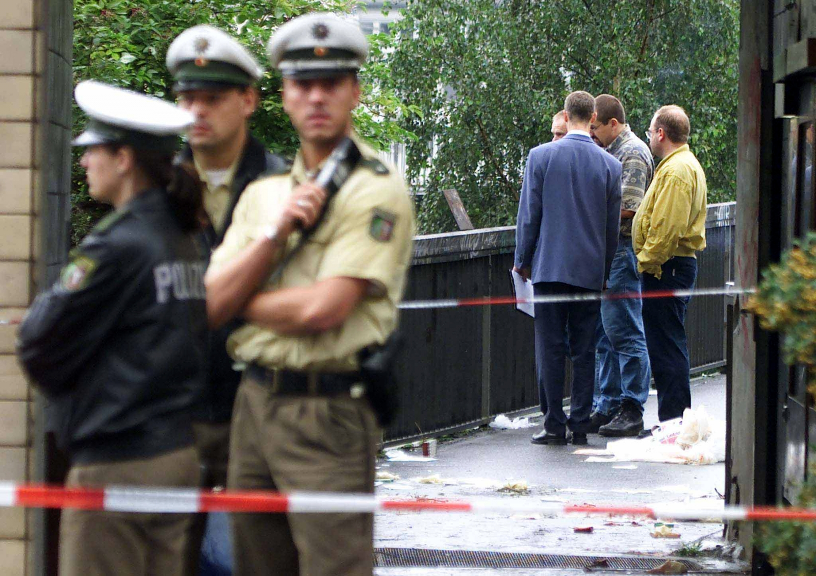 Police investigates at the scene of crime after a bomb blast at a city train station in the center of Duesseldorf, Germany, July 27 2000.