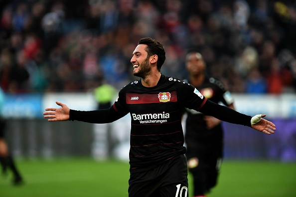 Leverkusen's Calhanoglu waives salary during Federation Internationale de Football Association ban